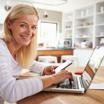 Woman working on laptop at home